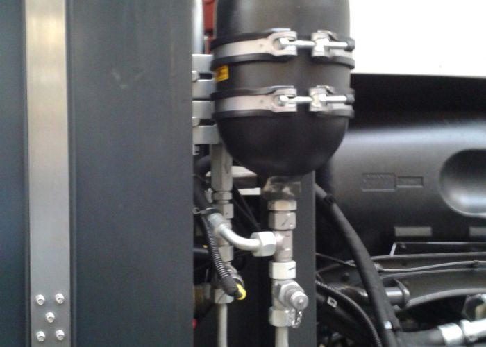 Hydraulic accumulator installed on a truck